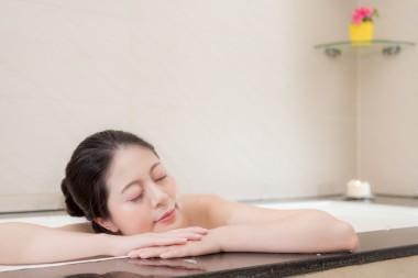 beauty smiling woman feeling tired leaning on bathtub side sleeping when she bathing in bathroom for relaxing.